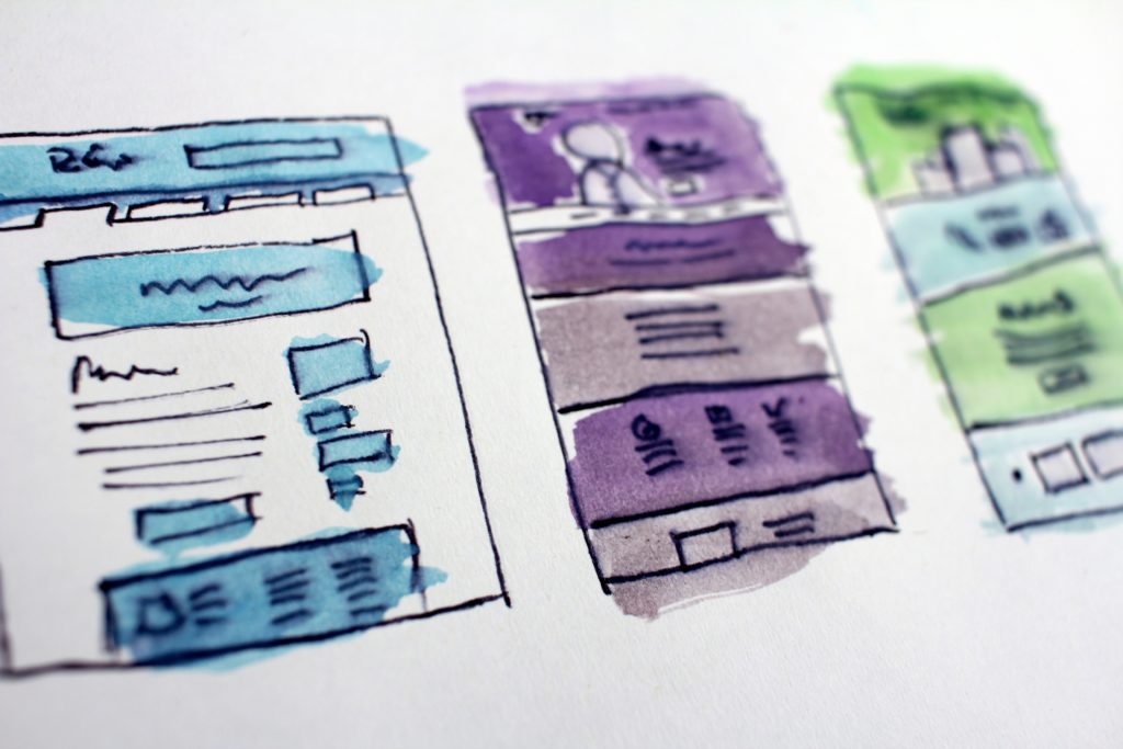 UI/UX design: colorful rough sketches of the user interface on paper