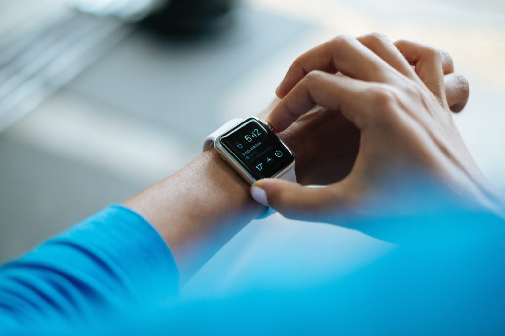IT Healthcare: a person is checking a smartwatch