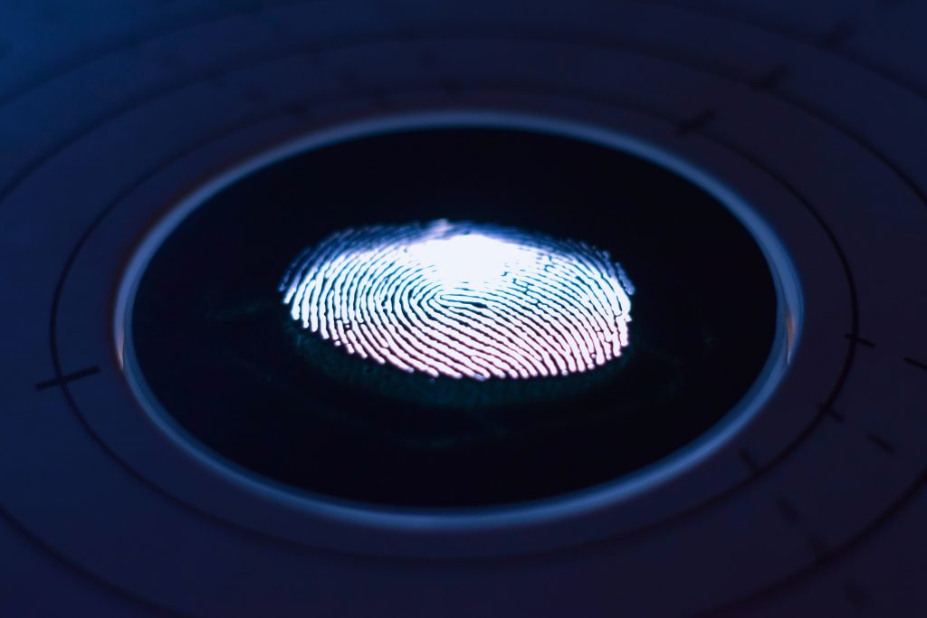 Biometric identifiers: a closeup of a fingerprint on a sensor