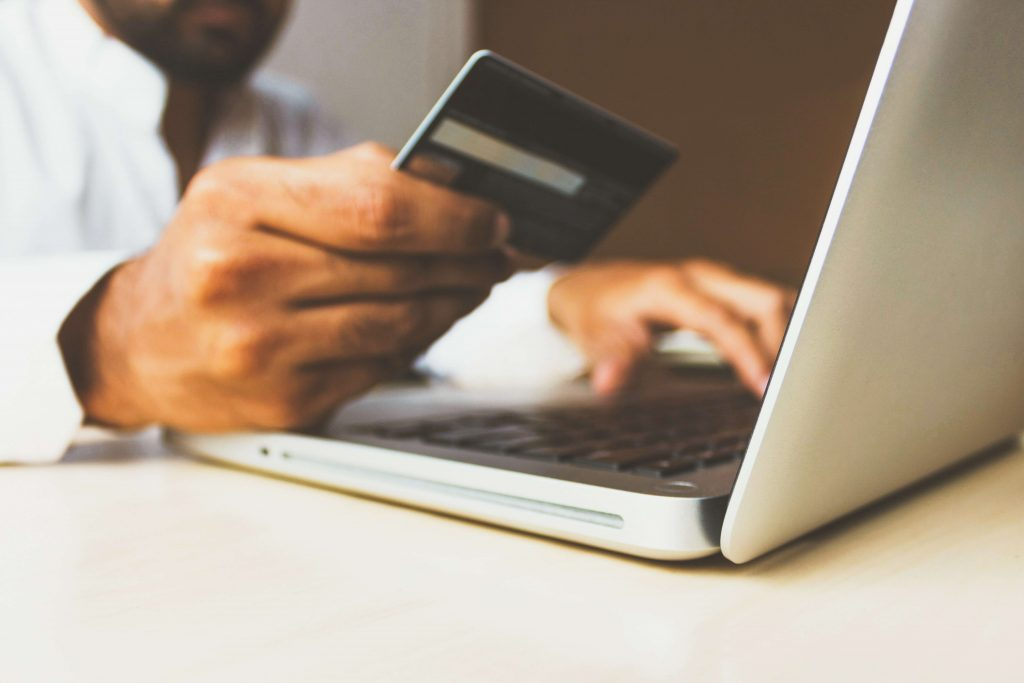 A buyer engaging in eCommerce by making an online purchase with the credit card