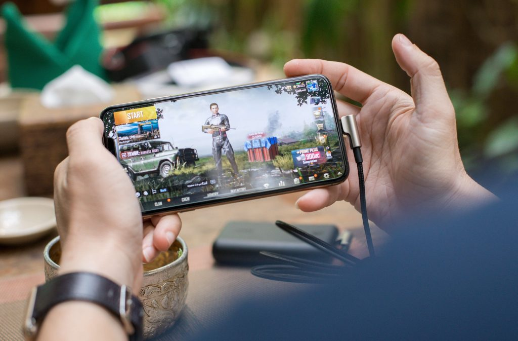 A person playing eSports on a mobile device