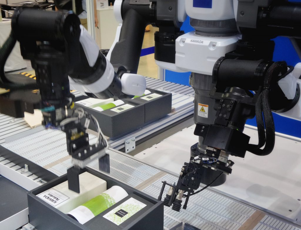 Manufacturing in Industry 4.0 using industrial robots, internet of things, amd machine to machine communications