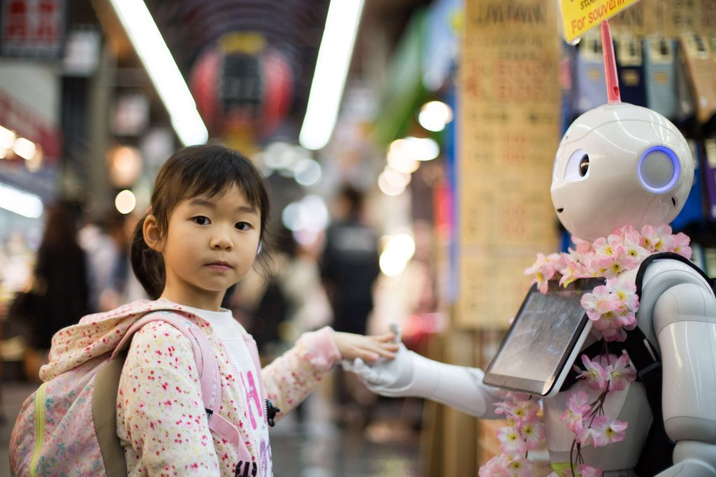 A robot with AI-powered social intelligence holding a girl's hand