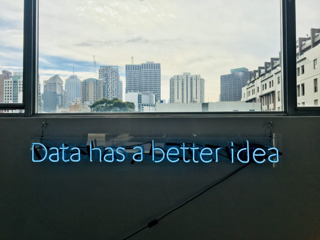 Explanation of artificial intelligence: data has a better idea written with neon lights on a wall