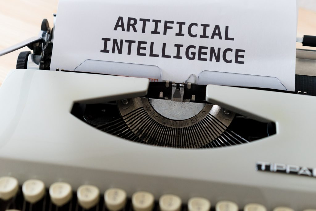 Artificial Intelligence printed on a sheet of paper set in the typing machine.