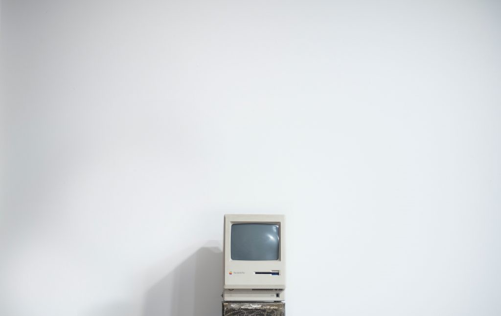 Old computer against the white wall
